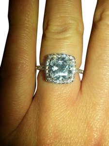 9.2.5 beautiful swarovski crystal and white sapphire princess ring. size7