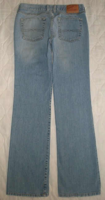 Lucky Brand Classic 5 Pocket Style *zip Fly *cotton/Spandex *machine Washable Leg Opening *distressing Detail *mid Rise Boot Cut Jeans-Light Wash