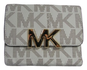 c5f6ceb337eb Michael Kors FLORENCE MK SIGNATURE TRIFOLD WALLET IN VANILLA