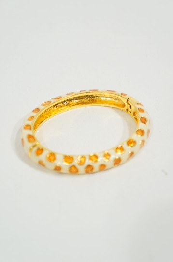 Kenneth Jay Lane Kenneth Jay Lane White & Metallic Orange Enamel Animal Print Spotted Magnetic Clic Clac Bangle Bracelet.