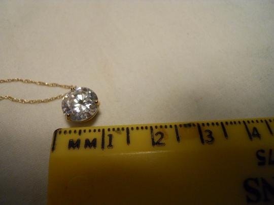 unknown 10 kt gold CZ pendant