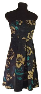 Guess short dress Black with gold and green flowers on Tradesy