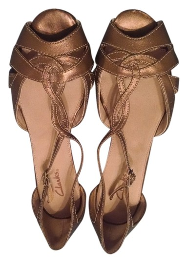 Preload https://item2.tradesy.com/images/clarks-copper-wedges-size-us-75-regular-m-b-1241221-0-0.jpg?width=440&height=440