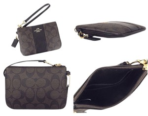 Coach Wristlet in Black/ Brown