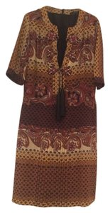 Gucci short dress 100% silk in a tan/gold, with some black and red detail throughout the print on Tradesy