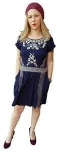 Alya short dress Navy Embroidered on Tradesy