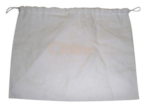 Chloé Brand New Chloe' Sleeper/ Dust Bag or Protective Cover White cotton with Tan logo Size 12 width x 9 Length. Drawstring Bag