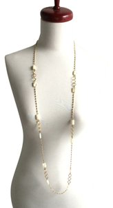Gold tone chain faceted mother of pearl beads