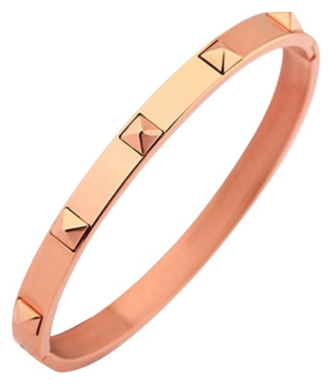 Preload https://item2.tradesy.com/images/rose-gold-spikey-pyramid-5-x-the-love-of-spikes-bangle-bracelet-1251936-0-2.jpg?width=440&height=440