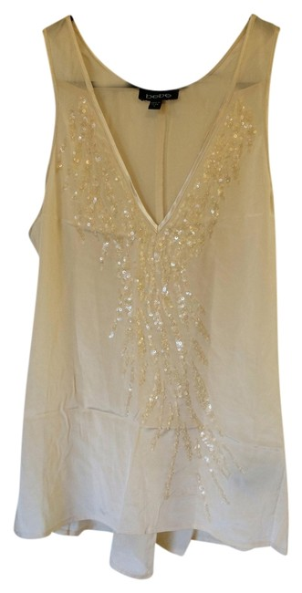 Preload https://item4.tradesy.com/images/bebe-cream-with-sequins-racer-back-camisole-tank-topcami-size-4-s-1253933-0-0.jpg?width=400&height=650