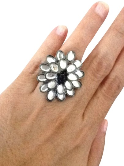 Preload https://item1.tradesy.com/images/other-nwot-expandable-flower-ring-1254590-0-0.jpg?width=440&height=440