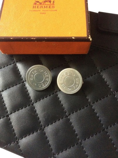 Hermès Silver tone round clip earrings