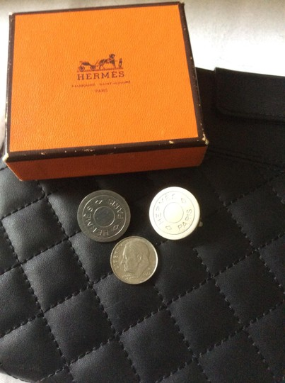 Hermes Silver tone round clip earrings