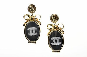 Chanel Vintage Chanel Gold Tone Mirror Cc Bow Oversized Clip On Statement Earrings