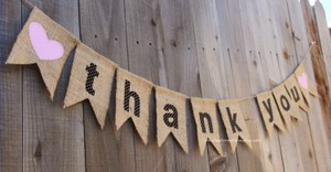 Brown Burlap Black Polka Dot Letters and Orange Heart Thank You Banner In