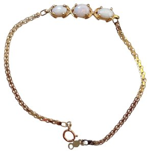 STAMPED ATL 14K YELLOW GOLD BRACELET WITH OPAL STONE