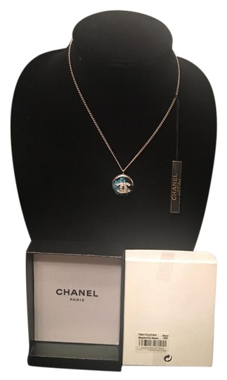 Preload https://item5.tradesy.com/images/chanel-silver-crystal-cc-logo-tweed-pendant-necklace-1264949-0-5.jpg?width=440&height=440