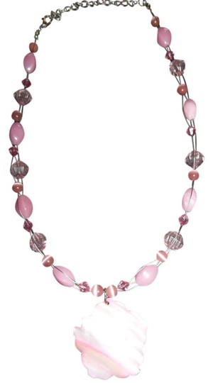Preload https://item3.tradesy.com/images/unknown-pink-flower-shell-pendant-w-pink-beads-1274887-0-0.jpg?width=440&height=440