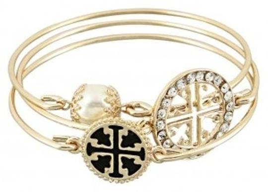 Preload https://item4.tradesy.com/images/goldtone-new-tory-burch-style-bangles-set-of-3-bracelet-127803-0-0.jpg?width=440&height=440