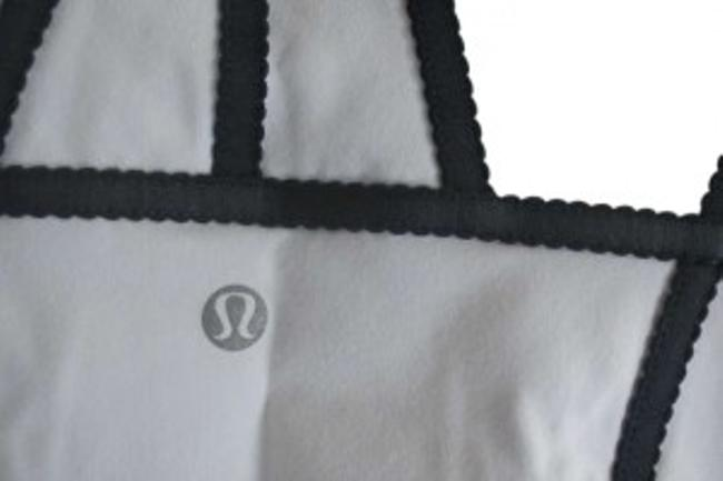 Preload https://img-static.tradesy.com/item/127849/lululemon-white-with-dark-gray-activewear-top-size-6-s-28-0-0-650-650.jpg
