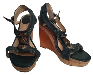 Frye black and tan Wedges