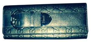 Gucci Metallic olive green Clutch