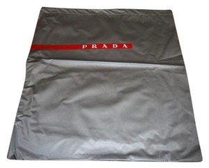 Prada New Large Prada Light Gray PVC Sleeper/ Dust Bag with red and white Logo Size: 14 inch width 15 inch Length Material: PVC Condition New Draw string