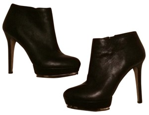 Vince Camuto black, gold accent around sole, zipper gold Boots