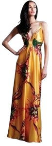 NIKA Attribute: * Care: Dry Clean * Length: 61 * Length Type: To Hem * Features: Intricate Back Design Embellished Waist 32 Dress
