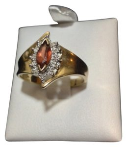 Other 10KP YELLOW GOLD RING WITH BROWN/RED STONE