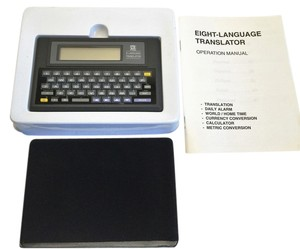 OREGON SCIENTIFIC 8-Language Translator Model# TL-218D; Translation, Daily Alarm, World/Home Time, Currency Conversion, Calculator & Metric Conversion [ Roxanne Anjou Closet ]
