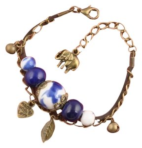 Asian Ceramic Beads and Elephant/Heart/Leaf Charm Bracelet