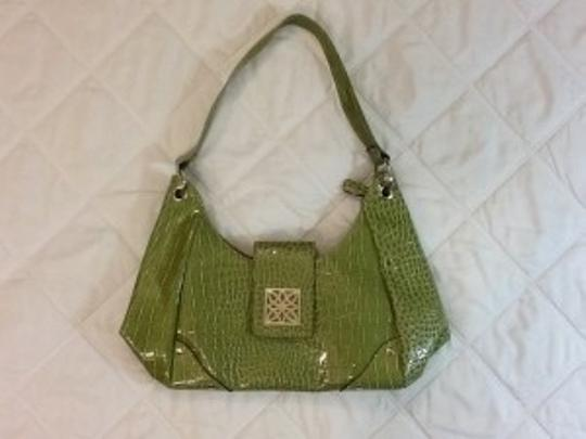 Preload https://item5.tradesy.com/images/green-with-silver-accents-faux-aligator-pattern-tote-12904-0-0.jpg?width=440&height=440