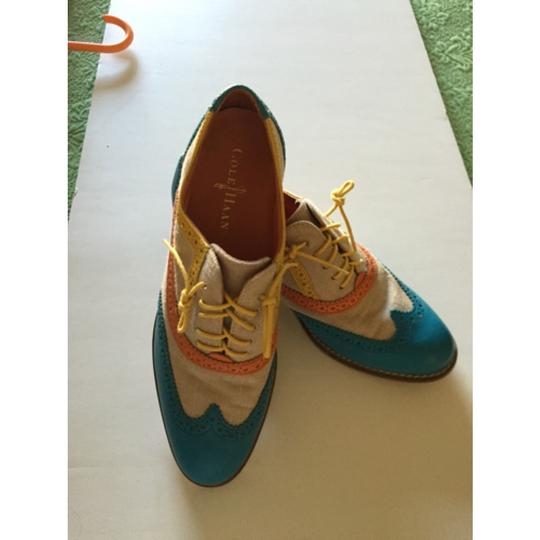 Cole Haan Teal, orange and off white. Flats