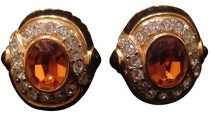 Replica collection Gold toned oval shaped clip-ons rhinestones black orange
