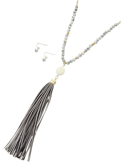 Preload https://item2.tradesy.com/images/gold-tone-grey-suede-white-semi-precious-neck-and-earring-necklace-12917956-0-1.jpg?width=440&height=440