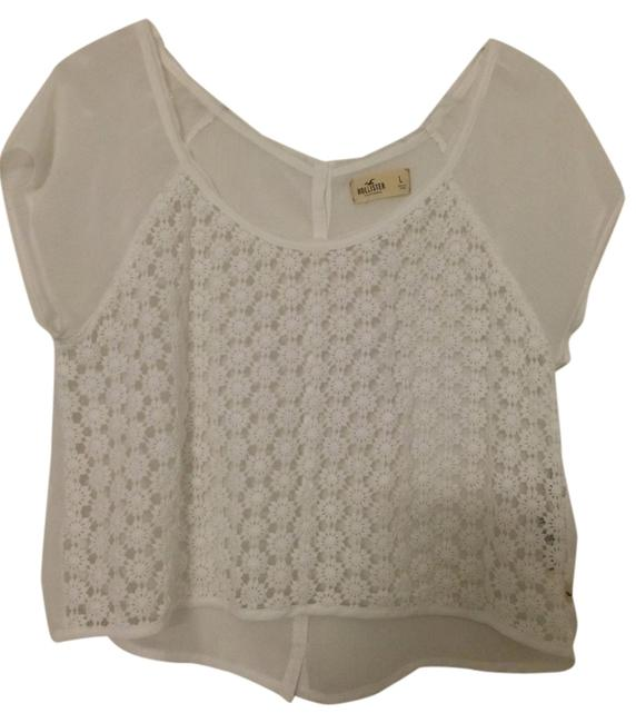 Preload https://item2.tradesy.com/images/hollister-white-blouse-size-12-l-1292246-0-0.jpg?width=400&height=650