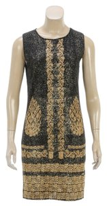 Chanel short dress Black/Gold on Tradesy