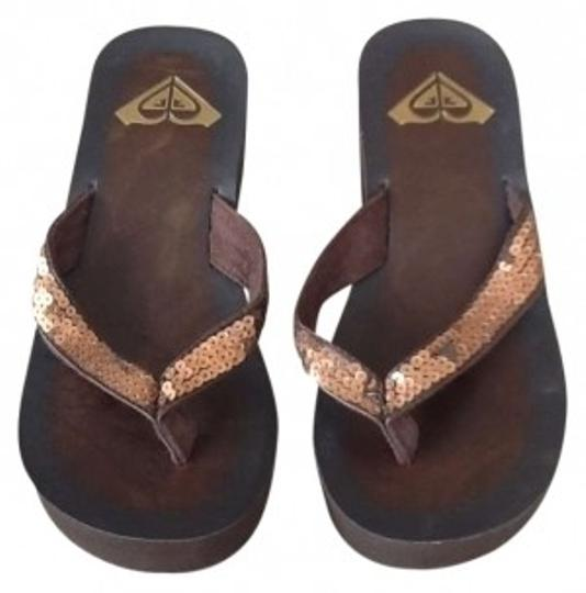 Preload https://item1.tradesy.com/images/roxy-brown-wedge-flip-flops-sandals-size-us-6-129645-0-0.jpg?width=440&height=440
