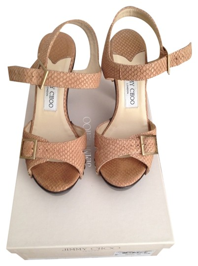 Preload https://item2.tradesy.com/images/jimmy-choo-103-urban-embossed-leather-nude-sandals-size-us-7-1301661-0-0.jpg?width=440&height=440
