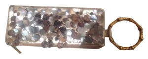 Trina Turk Shells Gold Clutch