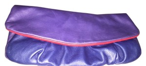 Elie Tahari Blue with red inside Clutch