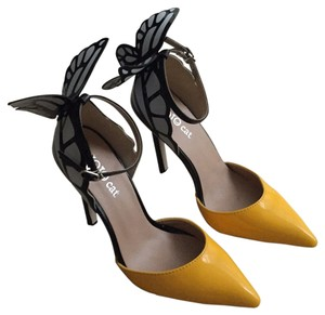 Yellow, black, white Pumps