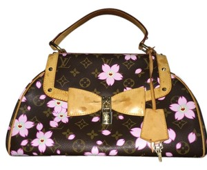 Louis Vuitton Satchel in Brown. Pink