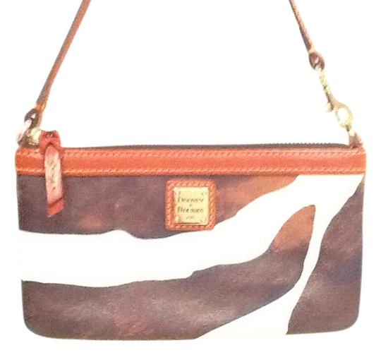 Preload https://item5.tradesy.com/images/dooney-and-bourke-brown-white-print-leather-wristlet-1305569-0-0.jpg?width=440&height=440