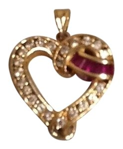 Unknown 14 karat yellow gold heart pendant with ruby and white sapphire stones