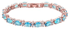 Giselle Bridals 40.00 Ct Oval & Round Blue Topaz Color CZ Rose Gold Plated Tennis Bracelet