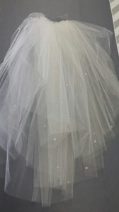 Ivory Multi Layer Elbow Length Tulle Veil With Unfinished Edge And Clear Crystal Accents