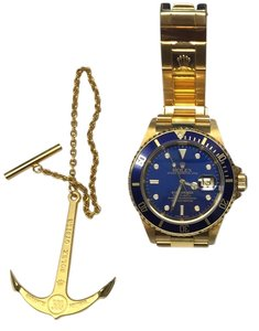 Rolex SUBMARINER WATCH WITH BLUE FACE AND BLUE BEZEL ALL GOLD WATCH 18KT