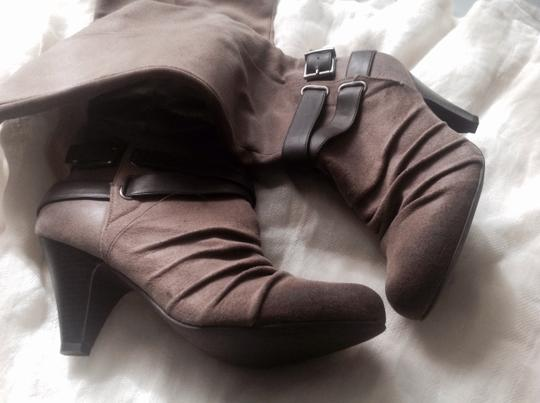 Jessica Simpson Like New. Great Style Light Brown with medium Brown leather details. Boots